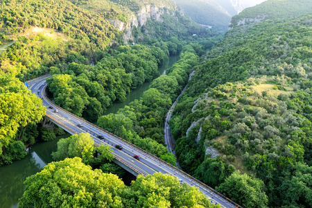 bridge in the forest: Aerial view of the bridge and the road over the river Pinios in the green valley of Tempe in Greece
