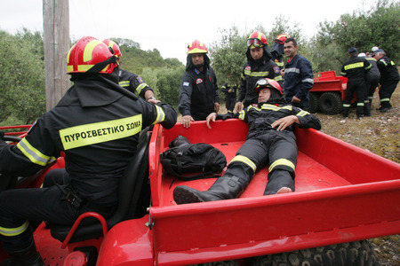 ILIA,GREECE,MAY 21,2015:Pan-European exercise of the Fire Brigade with evacuation and village houses complex, stalking and arson suspects arrested them, rescuing injured firefighters and citizen
