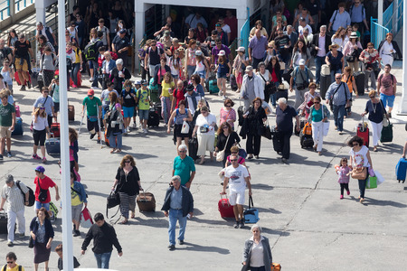 disembark: PAROS, GREECE, MAY 17, 2015: Passengers board the ship at the port of Paros in Greece.The Paros is an island in Cyclades that accepts too many tourists every year Editorial