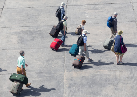 accepts: PAROS, GREECE, MAY 17, 2015: Passengers disembark from the ship at the port of Paros in Greece .The Paros is an island in Cyclades that accepts too many tourists every year