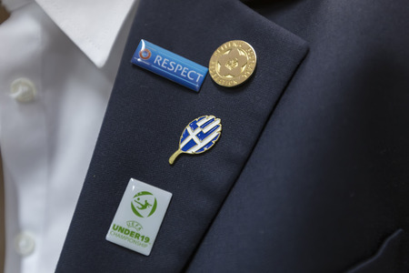 european championship: KATERINI, GREECE, JUNE 9,2015: Close-up of the official Uefa Under19 Championship, Greece and respect pins. Editorial