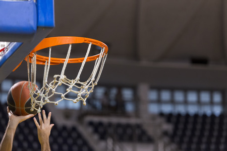 undefined: THESSALONIKI, GREECE, JUN 17, 2015: Undefined player hands throwing a ball through the net prior to the Greek Basket League game Aris vs Paok