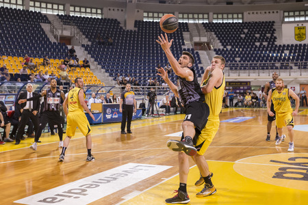 professional basketball league: THESSALONIKI, GREECE, JUN 17, 2015: Margaritis of Paok (L) in action with Vezenkov of Aris (R) during the Greek Basket League game Aris vs Paok Editorial