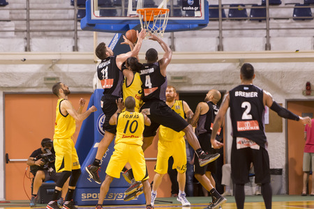 professional basketball league: THESSALONIKI, GREECE, JUN 17, 2015: Players of both teams in action during the Greek Basket League game Aris vs Paok Editorial