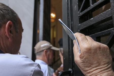 bank branch: THESSALONIKI, GREECE, JULY, 1 2015: Pensioners queue outside a National Bank branch as banks only opened for the retired to allow them to cash up to 120 euros in Athens