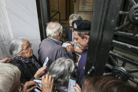greece: THESSALONIKI, GREECE, JULY, 1 2015: Pensioners queue outside a National Bank branch as banks only opened for the retired to allow them to cash up to 120 euros in Athens