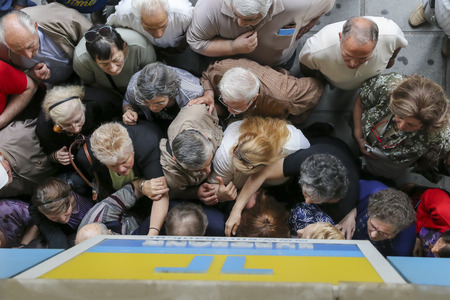 THESSALONIKI, GREECE, JULY, 1 2015: Pensioners queue outside a National Bank branch as banks only opened for the retired to allow them to cash up to 120 euros in Athens