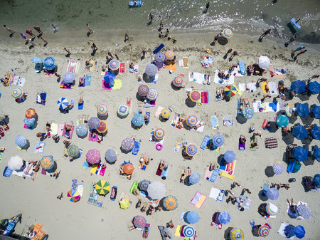 KATERINI, GREECE, JULY 5 2015: Aerial view of the beach of Katerini in Greece. colorful umbrellas and people who swims. Aerial shot Редакционное