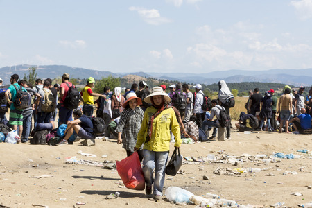 refugees: Idomeni, Greece - August 19 , 2015: Hundreds of immigrants are in a wait at the border between Greece and FYROM waiting for the right time to continue their journey from unguarded passages