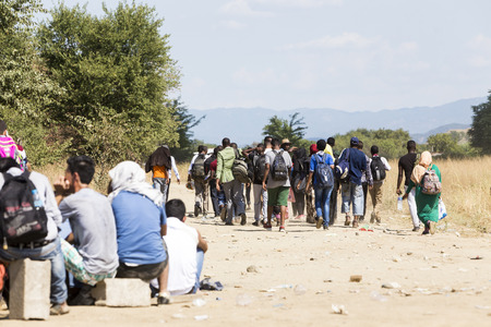 passages: Idomeni, Greece - August 19 , 2015: Hundreds of immigrants are in a wait at the border between Greece and FYROM waiting for the right time to continue their journey from unguarded passages