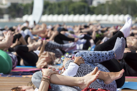 thessaloniki: THESSALONIKI, GREECE - JUNE 21, 2015: Thessaloniki open yoga day. People gathered to perform yoga training during the day, outdoor activities Editorial