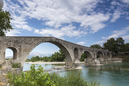 The Bridge of Arta is an old stone bridge that crosses the Arachthos river in the west of the city of Arta in Greece.