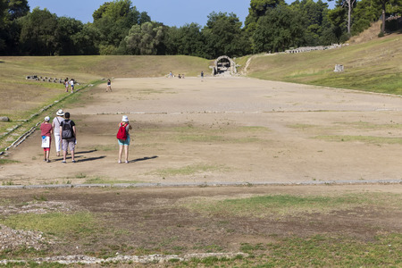 Olympia, Greece- August 9, 2015: Tourists at Olympia, birthplace of the Olympic games, in Greece.