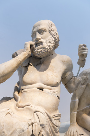 ancient olympic games: Ancient ruins of the Philippeion at Olympia, Greece. Detail of an ancient Greek statue of a human. Site of the ancient Olympic Games is situated on the Peloponnese. UNESCO world heritage site. Editorial