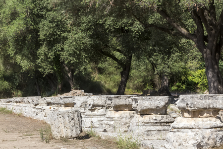 lintels: Remains of a Corinthian column in Olympia, Greece Stock Photo
