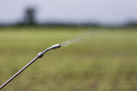 crop sprayer: Close Up of a Crop Sprayer, nozzle spraying fertilizer on crop Stock Photo