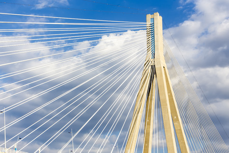 repetition: Cables and supports of bridge Rio-Antirio in Greece against blue sky