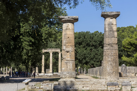 ruins is ancient: Olympia, Greece- August 9, 2015: Ancient ruins of the Philippeion at Olympia, Greece. The Archaeological Museum of Olympia, the most important of Greece. Editorial