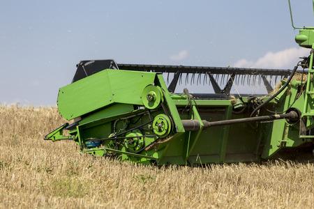 thessaloniki: Thessaloniki, Greece - June 21, 2015: Combine harvester harvesting wheat on sunny summer day in Greece