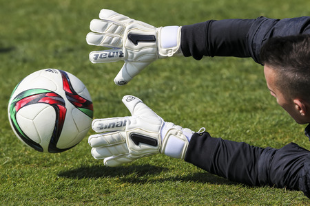 goal keeper: Thessaloniki, Greece- June 2, 2015: Goal Keeper of Paok with the ball in his hands during the team's training session, in Thessaloniki, Greece. Editorial