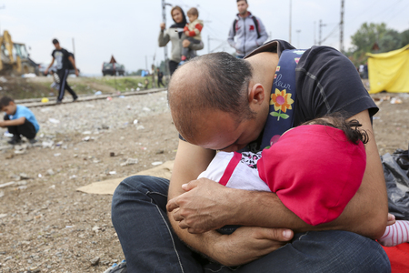 Idomeni, Greece - September 24 , 2015: Hundreds of immigrants are in a wait at the border between Greece and FYROM waiting for the right time to continue their journey from unguarded passages Éditoriale