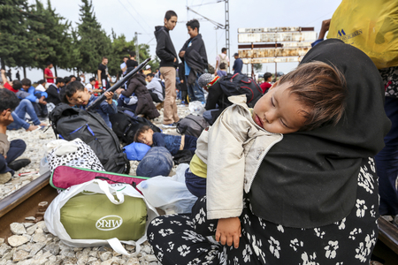 Idomeni, Greece - September 24 , 2015: Hundreds of immigrants are in a wait at the border between Greece and FYROM waiting for the right time to continue their journey from unguarded passages 에디토리얼