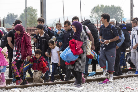 passages: Idomeni, Greece - September 24 , 2015: Hundreds of immigrants are in a wait at the border between Greece and FYROM waiting for the right time to continue their journey from unguarded passages Editorial
