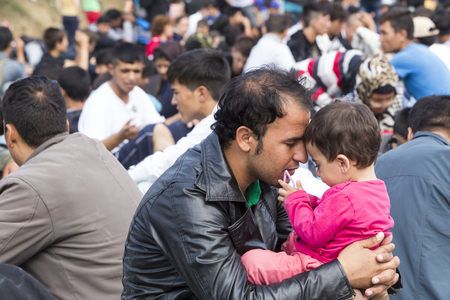 Idomeni, Greece - September 24 , 2015: Hundreds of immigrants are in a wait at the border between Greece and FYROM waiting for the right time to continue their journey from unguarded passages Редакционное