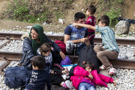 immigrants: Idomeni, Greece - September 24 , 2015: Hundreds of immigrants are in a wait at the border between Greece and FYROM waiting for the right time to continue their journey from unguarded passages Editorial