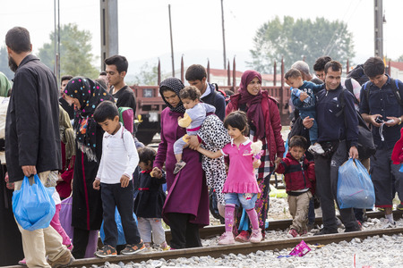 refugee: Idomeni, Greece - September 24 , 2015: Hundreds of immigrants are in a wait at the border between Greece and FYROM waiting for the right time to continue their journey from unguarded passages Editorial