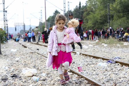 grief: Idomeni, Greece - September 24 , 2015: Hundreds of immigrants are in a wait at the border between Greece and FYROM waiting for the right time to continue their journey from unguarded passages Editorial