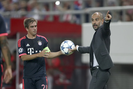 josep: Athens, Greece- September 16, 2015: Philipp Lahm (L) taking the ball from Coach Josep Guardiola (R) during the UEFA Champions League game between Olympiacos and Bayern, in Athens, Greece.