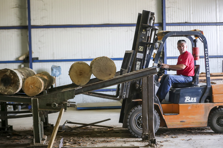 assemblies: Thessaloniki, Greece, July 8, 2015: Lift truck driver working in a wood factory in Greece. Editorial