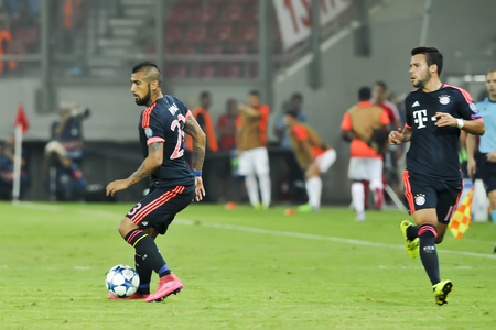arturo: Athens, Greece- September 16, 2015: Arturo Vidal (L) and Juan Bernat (R) during the UEFA Champions League game between Olympiacos and Bayern, in Athens, Greece. Editorial