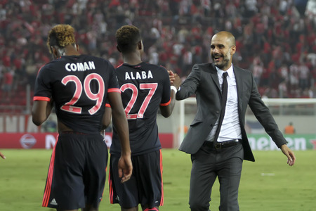 josep: Athens, Greece- September 16, 2015: Coach Josep Guardiola celebrates with the players of Bayern Munchen during the UEFA Champions League game between Bayern and Olympiacos, in Athens, Greece.