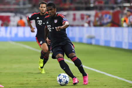 arturo: Athens, Greece- September 16, 2015: Douglas Costa (R) and Arturo Vidal (L) during the UEFA Champions League game between Olympiacos and Bayern, in Athens, Greece. Editorial