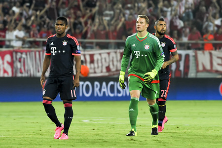 arturo: Athens, Greece- September 16, 2015: Arturo Vidal (R) Manuel Neuer (C) and Douglas Costa (L) during the UEFA Champions League game between Olympiacos and Bayern, in Athens, Greece.