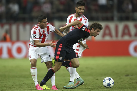manuel: Athens, Greece- September 16, 2015: Manuel da Costa (R) Thomas Muller (C) and Omar Elabdellaoui (L) during the UEFA Champions League game between Olympiacos and Bayern, in Athens, Greece.