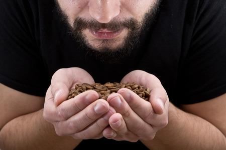 aromas: Man holding coffee and enjoys the aroma close up Stock Photo