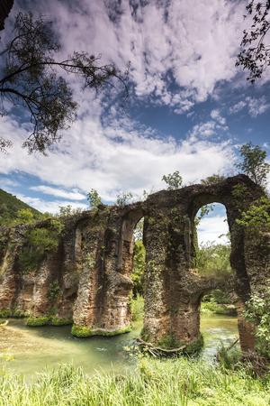 aqueduct: Roman aqueduct of Nikopolis against beautiful cloudy sky in Greece.
