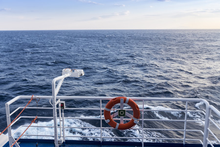 flotation: Personal flotation device on the deck of a ship