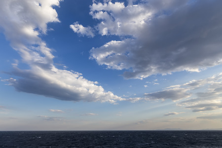 cumuli: Blue sky with clouds over sea. Nature composition. Stock Photo