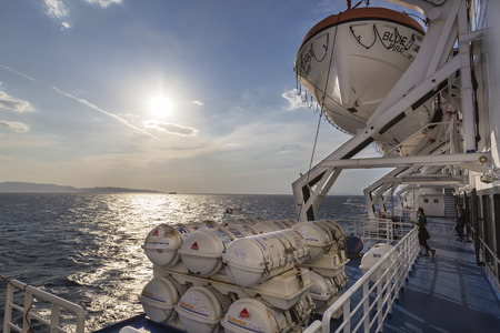onboard: Santorini, Grece- May 12, 2015: Barrels containing emergency liferafts on the ship, in Greece. RFD Surviva R Liferafts are equipped with a non-inflatable, easy-access boarding ramp