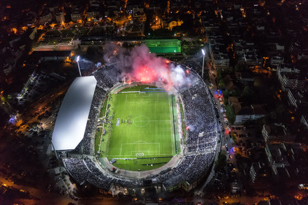 delirious: Thessaloniki, Greece, October 4 2015: Aerial soot of the Toumba Stadium full of fans during a football match for the championship between teams PAOK vs Olympiacos