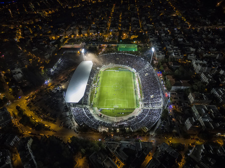 soot: Thessaloniki, Greece, October 4 2015: Aerial soot of the Toumba Stadium full of fans during a football match for the championship between teams PAOK vs Olympiacos