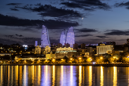 View of the waterfront and the city at night, in Baku, Azerbaijan. vintage tone filter