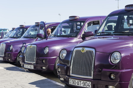 azeri: Azerbaijan, Baku - September 16, 2015: Local cabs waiting in line for passengers in Baku, Azerbaijan.