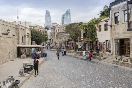 antiques: Azerbaijan, Baku - September 16, 2015: Icheri Sheher (Old Town) and the Flame Towers of Baku, Azerbaijan. Typical tourist shop with souvenirs and antiques.