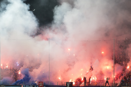 fanatics: Thessaloniki, Greece, Oktober18 2015: Fans and supporters of Hercules (Iraklis) team light flares  during the Greek Superleague match PAOK vs Hercules (Iraklis) Editorial