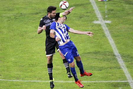 alexandros: Thessaloniki, Greece, Oktober18 2015: Alexandros Tziolis (L) of Paok and Jonh Pasas of Hercules (Iraklis) (R) in action during the Greek Superleague match PAOK vs Hercules (Iraklis) Editorial